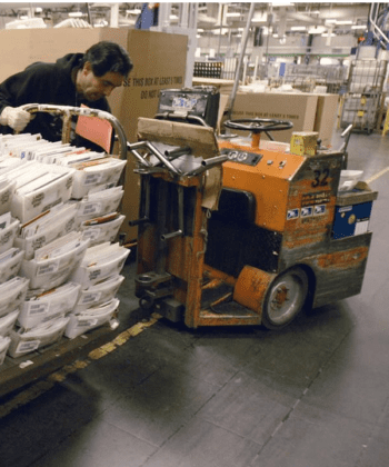Man loading machine at Post Office